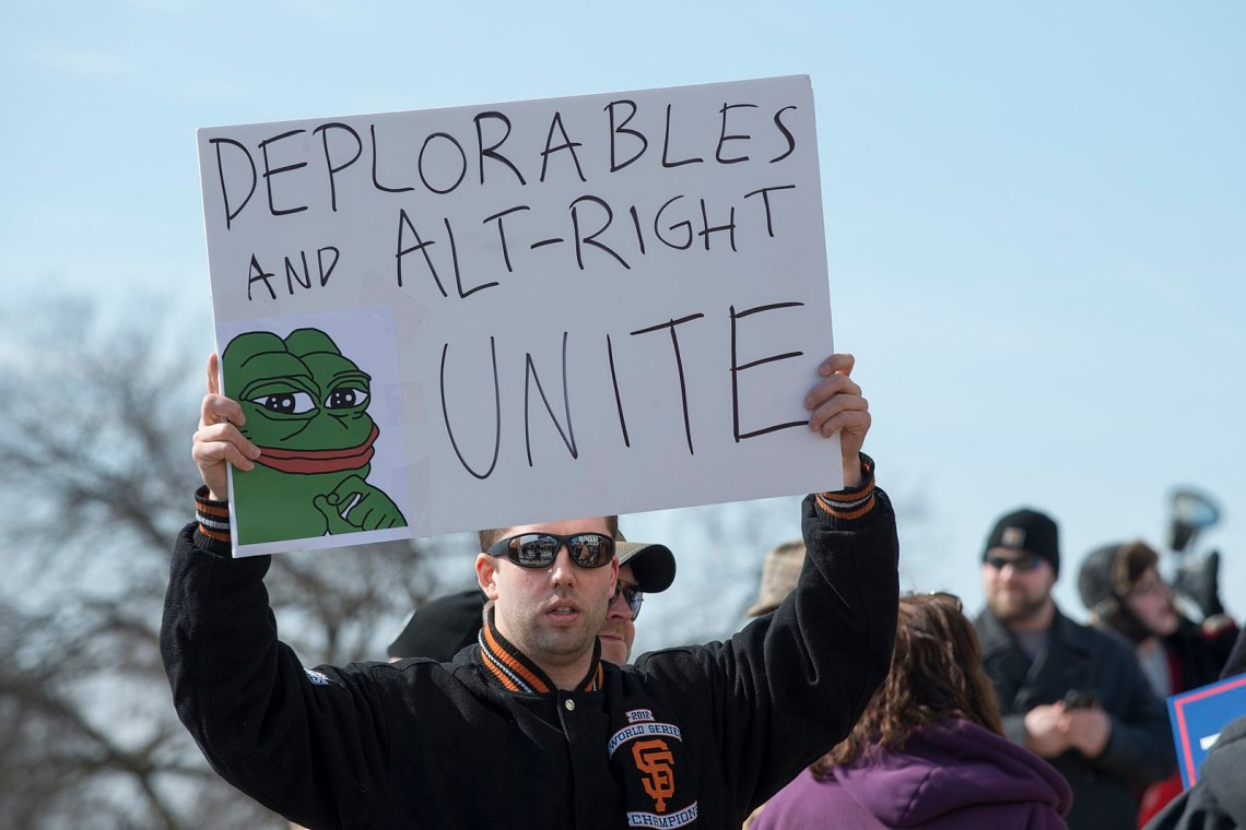 AltRight Dude Holds Up A Sign Loving Being AltRight