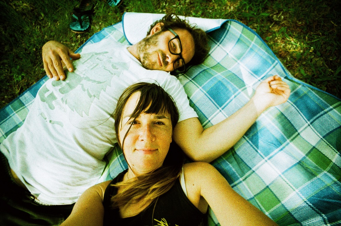 couple laying down, happy couple, what it means to be in love, being in love