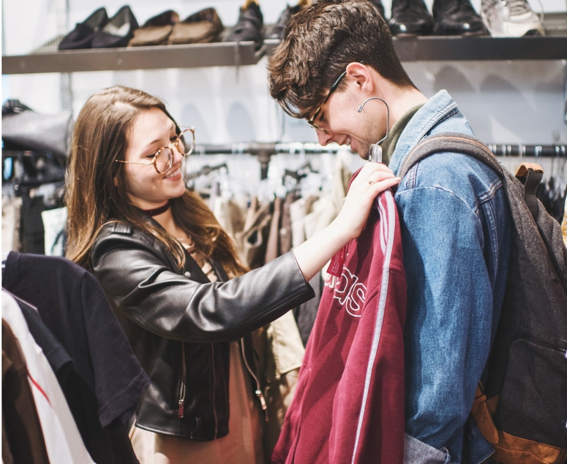 couple putting on clothes, happy couple, couple believing in love