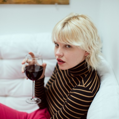 Girl Drinking Wine On The Couch Sassily