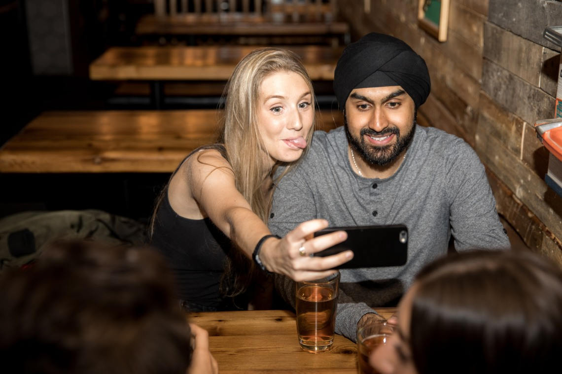 problem with modern dating, couple taking a selfie,