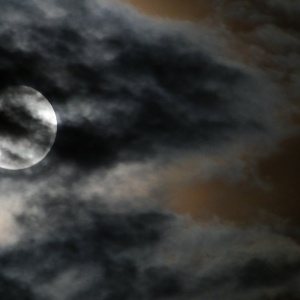 Creepy Full Moon On A Cloudy Night