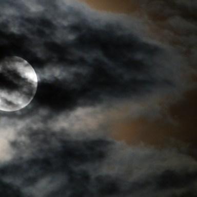 Creepy Full Moon On A Cloudy Night