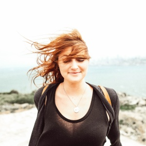 Woman smiling with the wind blowing outdoors