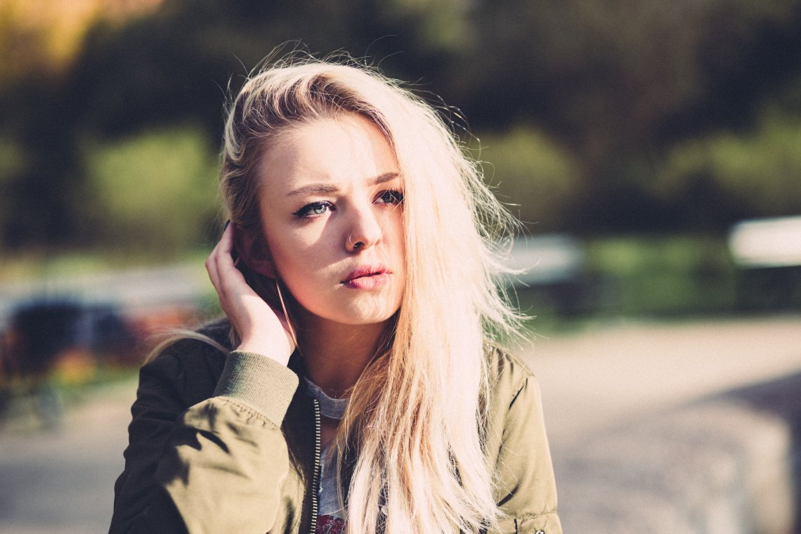 Blonde woman staring into distance