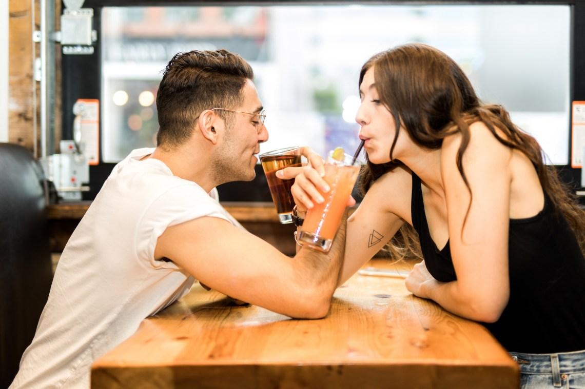 Cute couple drinks a milkshake