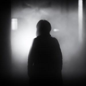Person walks into a dark, scary room