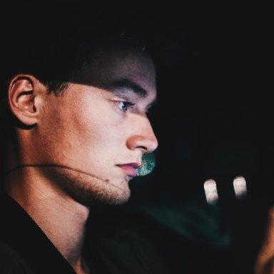 Man Texts At Night In Car