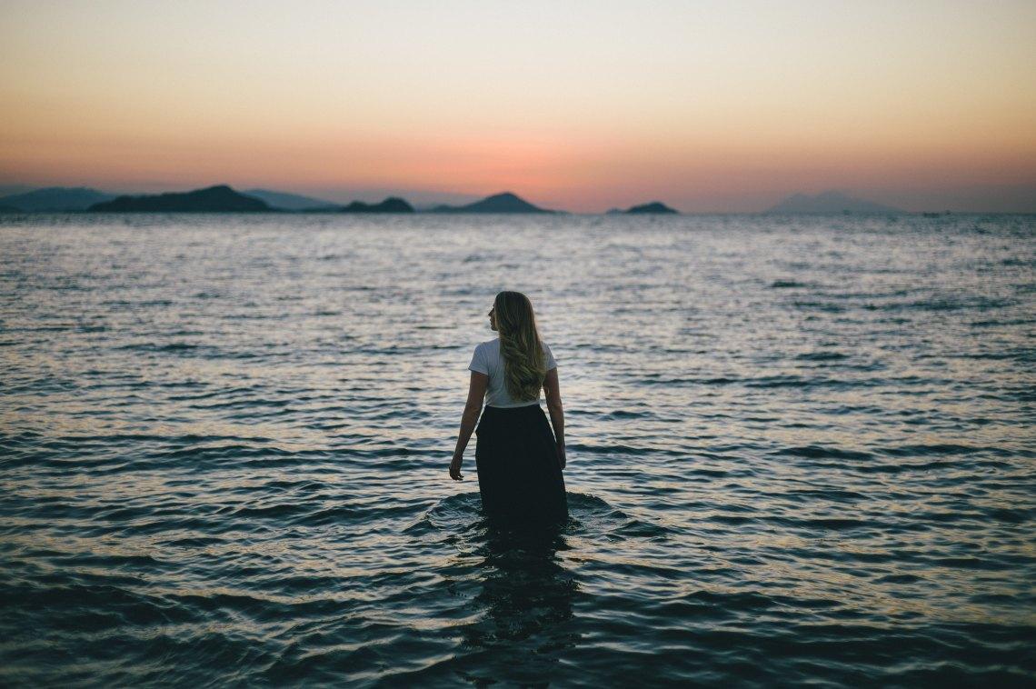 girl in ocean looking out