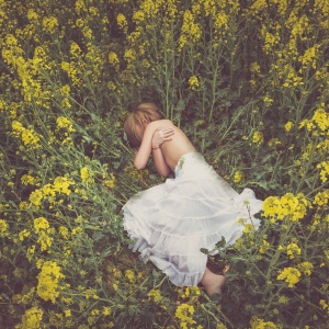 Woman in white skirt laying in field