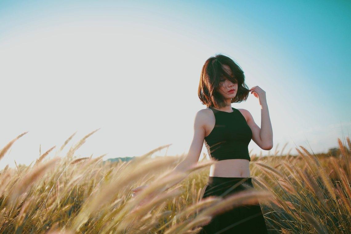 Woman standing in golden field