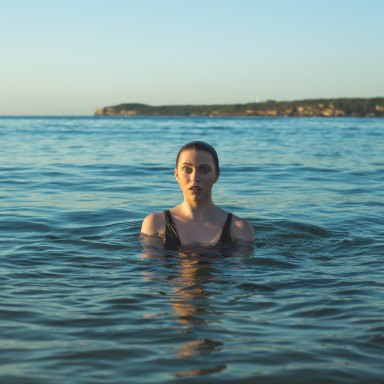 A woman swims in the middle of the ocean