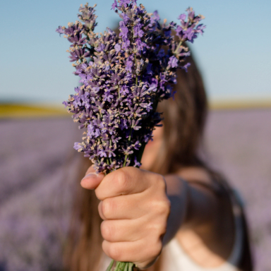 Resilient girl holds flowers