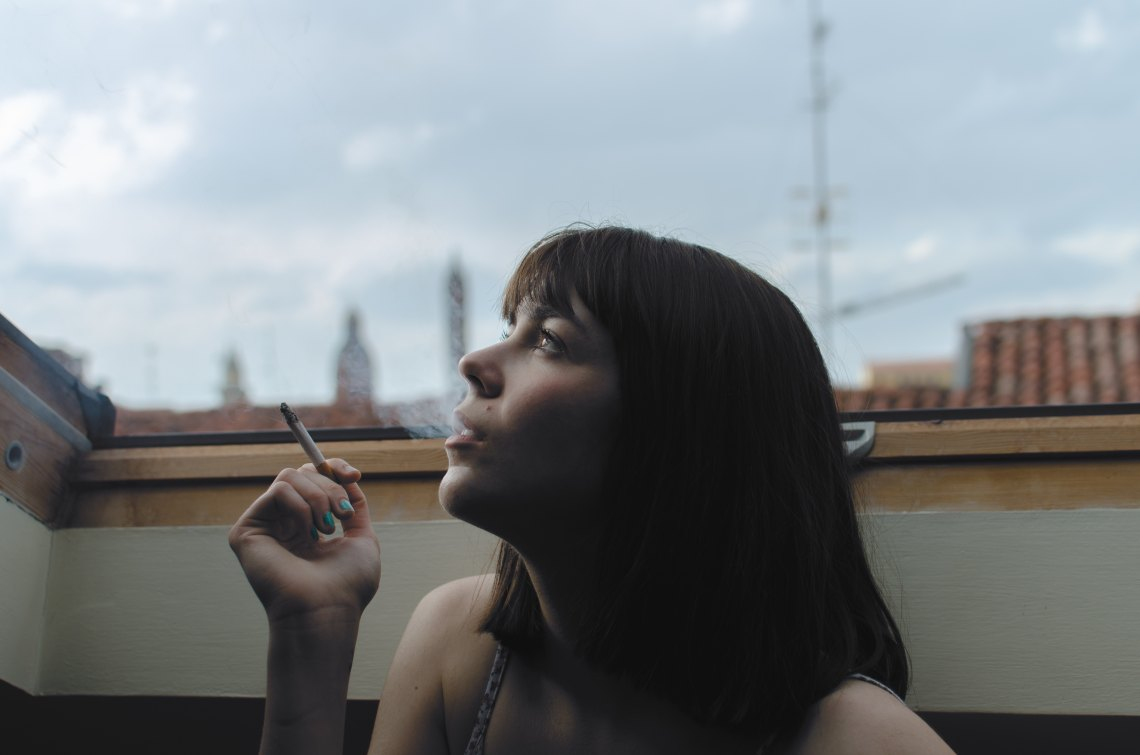 Girl On Roof Smoking And Thinking