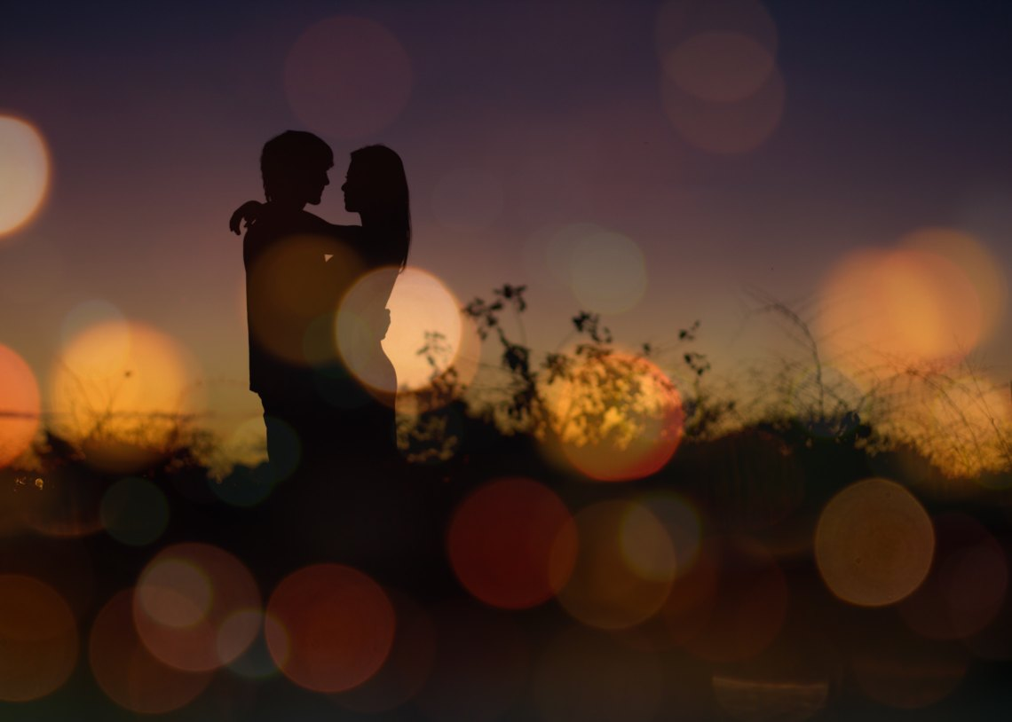 Couple's silhouette against sunset