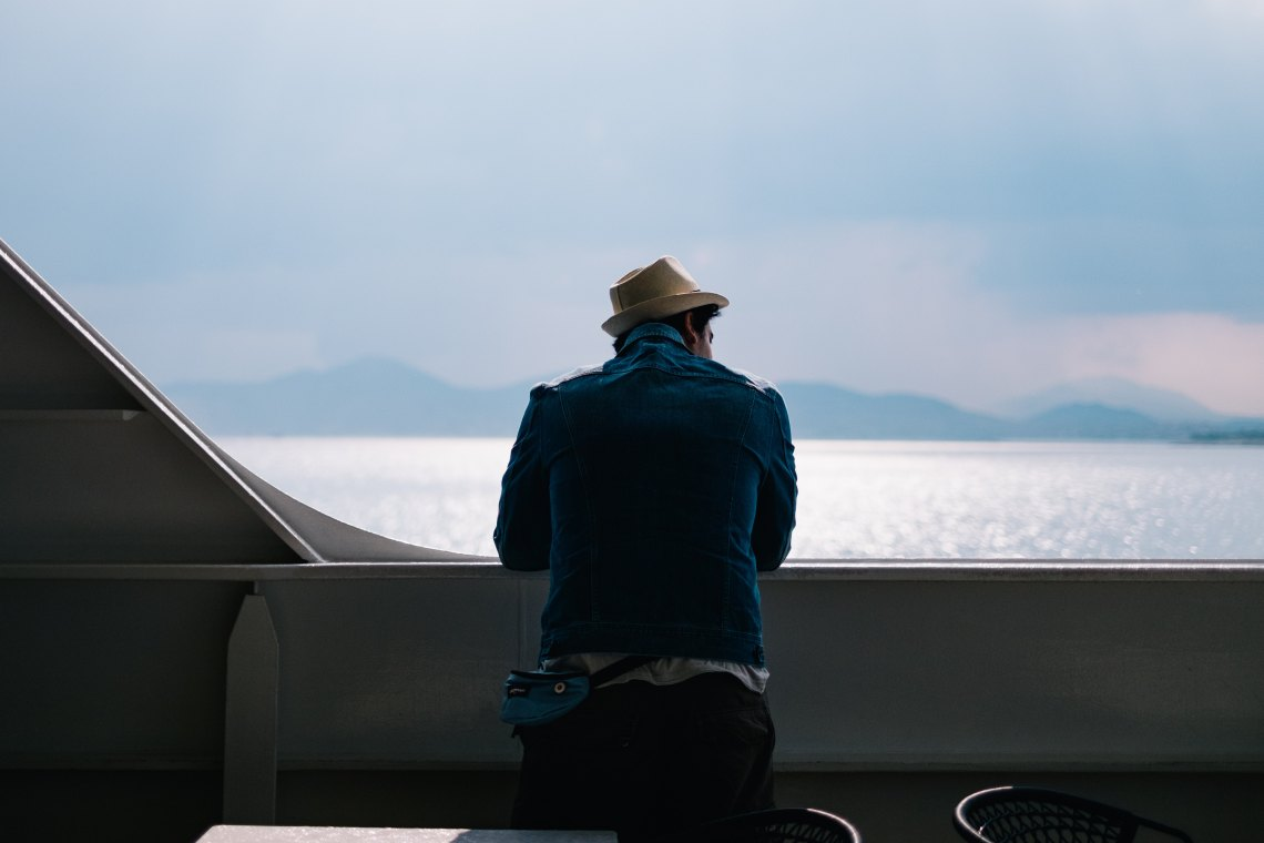 Guy with hat looking over water