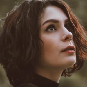 Brunette woman nose ring turtleneck