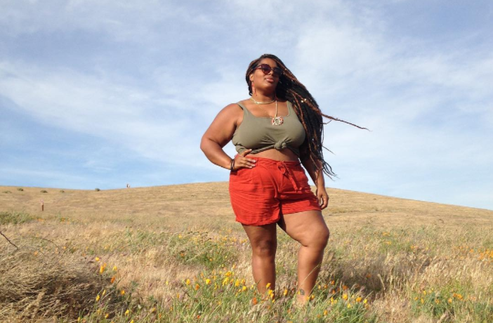 Travel bloggerAnnette Richardson standing in a field while traveling the world