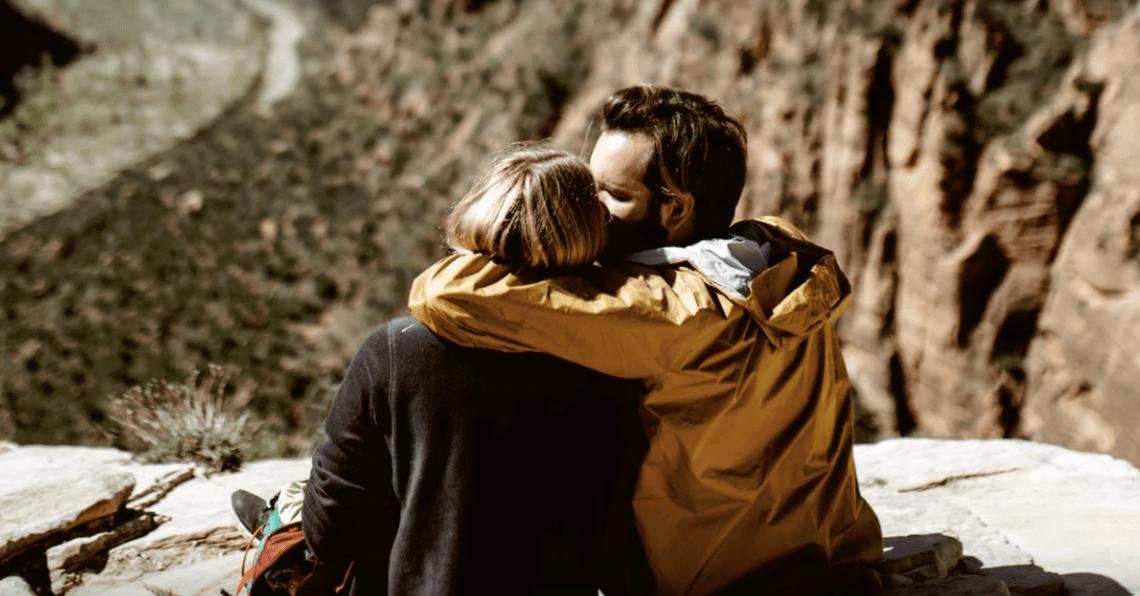 Couple kissing on a hike
