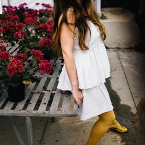 sad girl with flowers