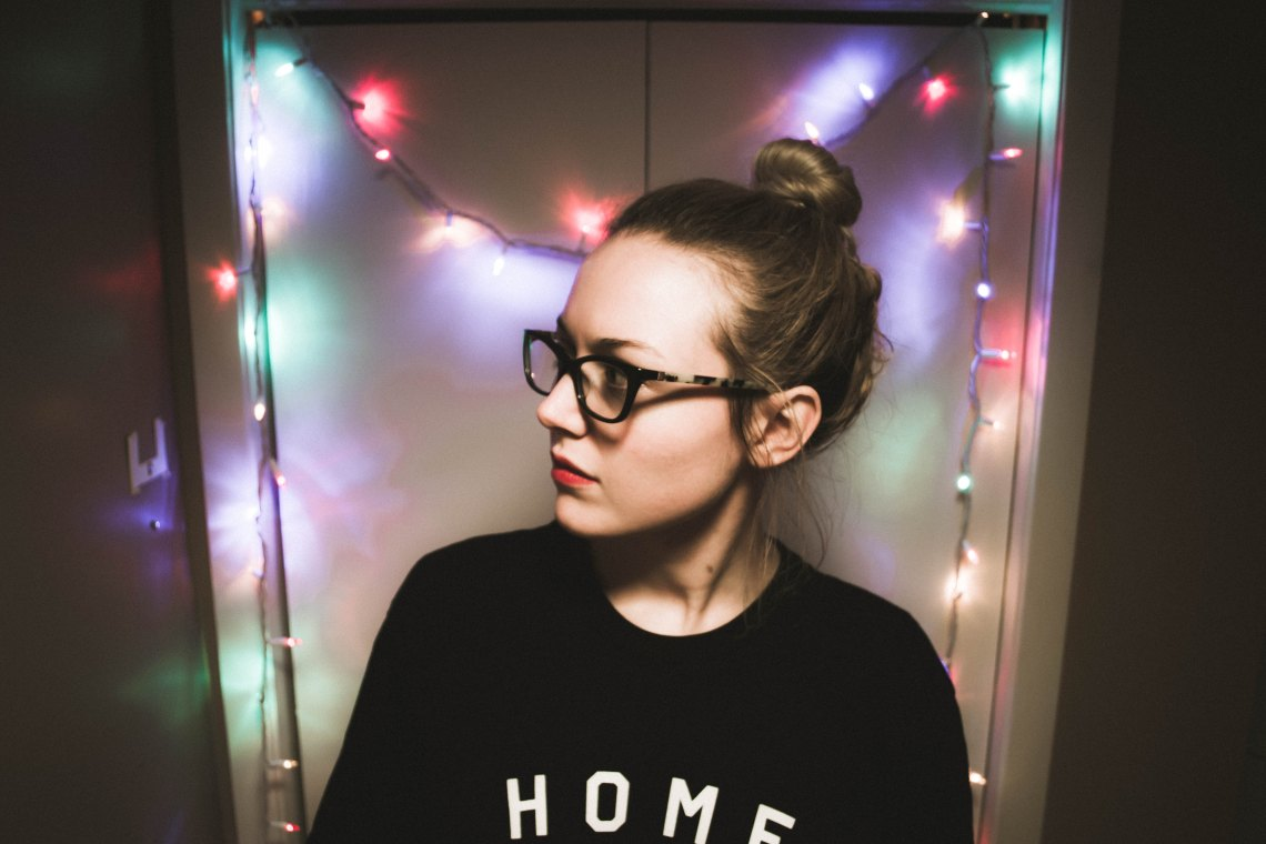 girl with glasses and lights