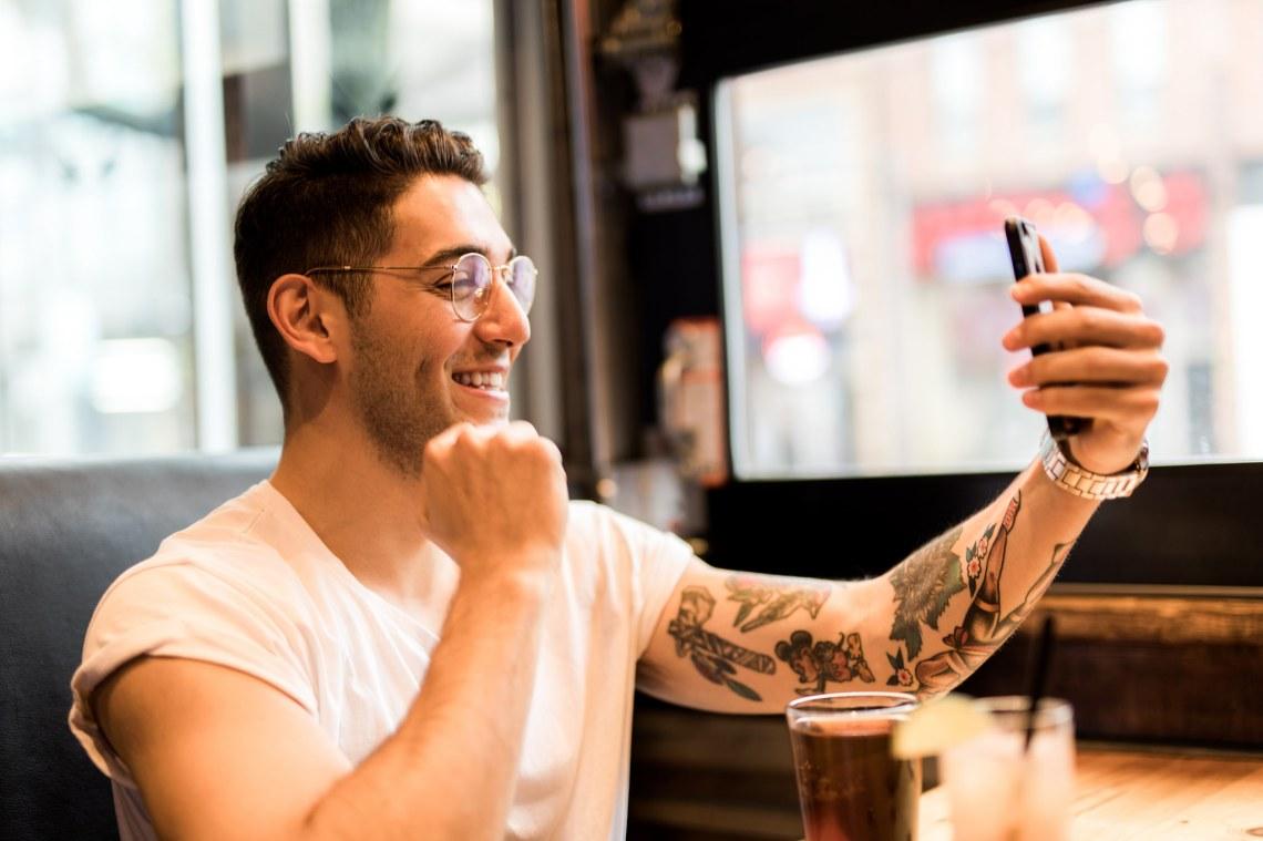 guy taking selfie