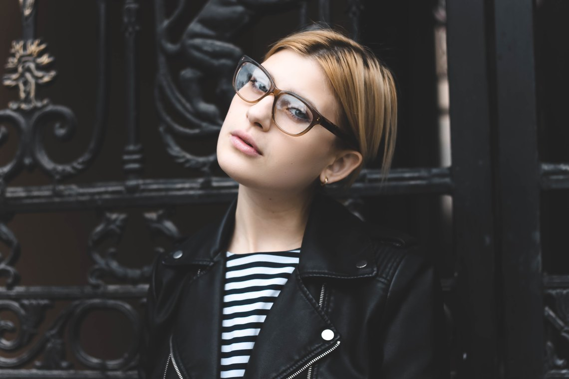 woman in glasses looking at camera