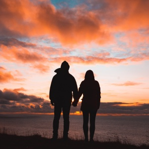 Couple in front of sunset