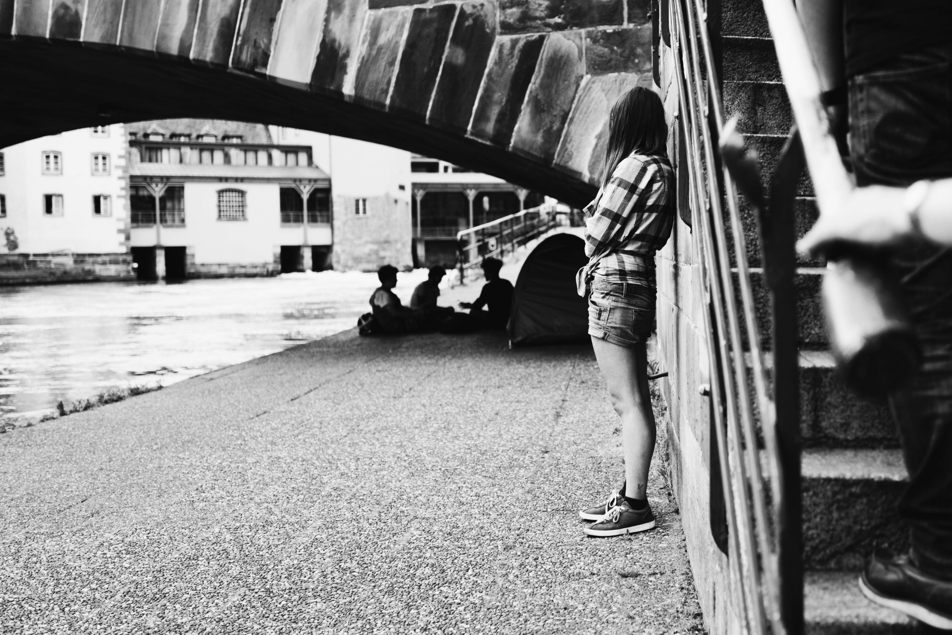 black and white girl under bridge