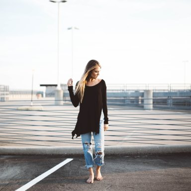 Woman standing in parking lot