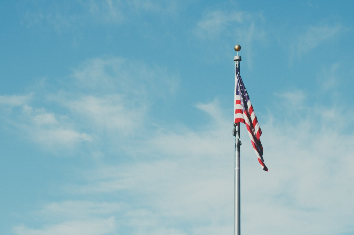 A single american flag waving in the wind