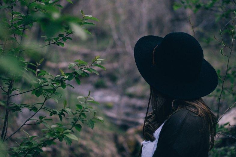 woman standing in woods