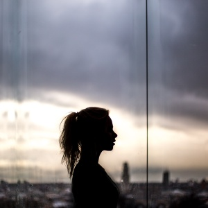 Woman's silhouette in front of sky
