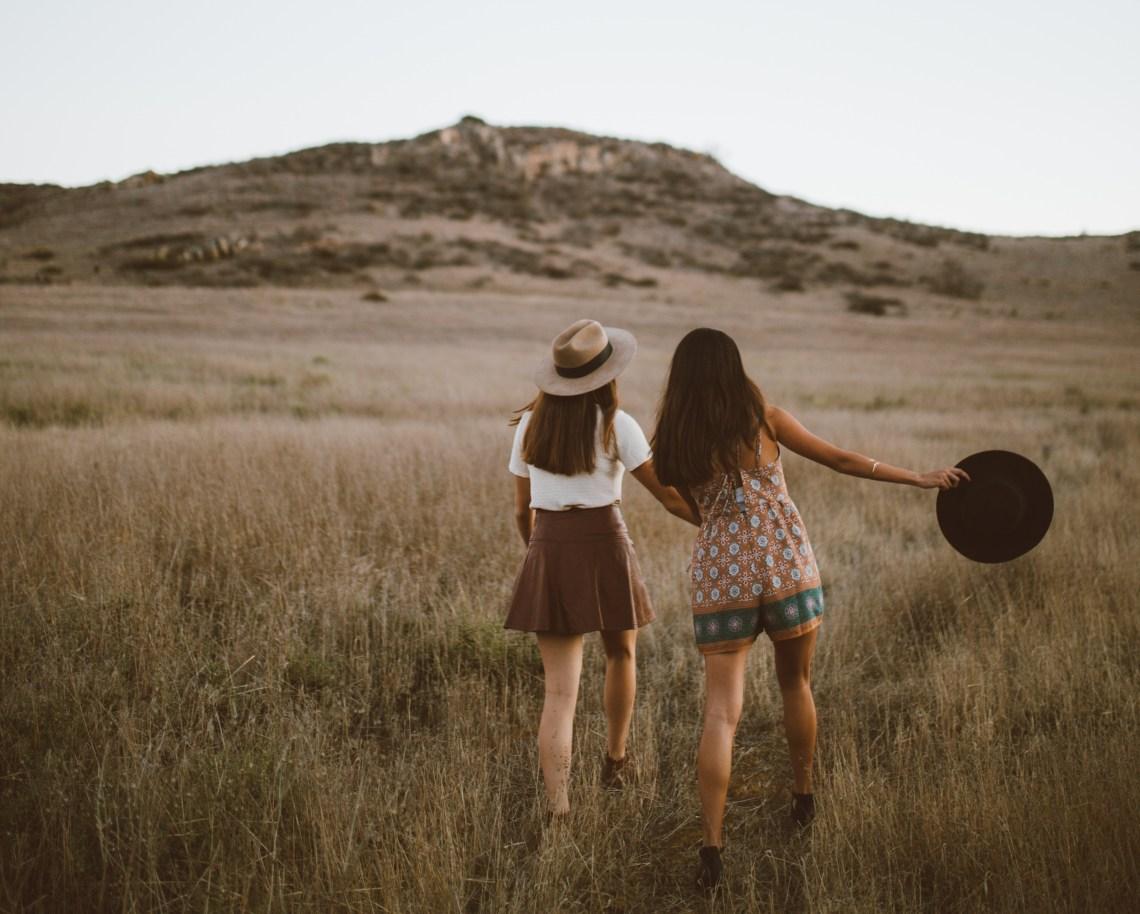 girls running in a field, dancing girls, country music, best love songs, best love songs in country music