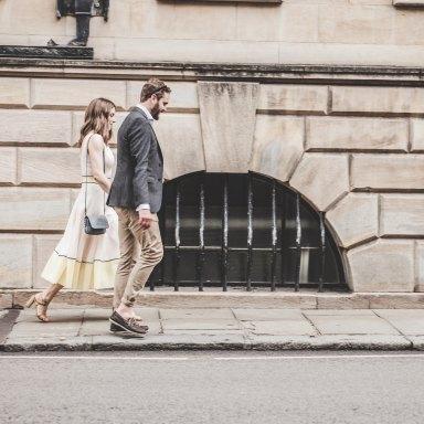 Couple walking down street