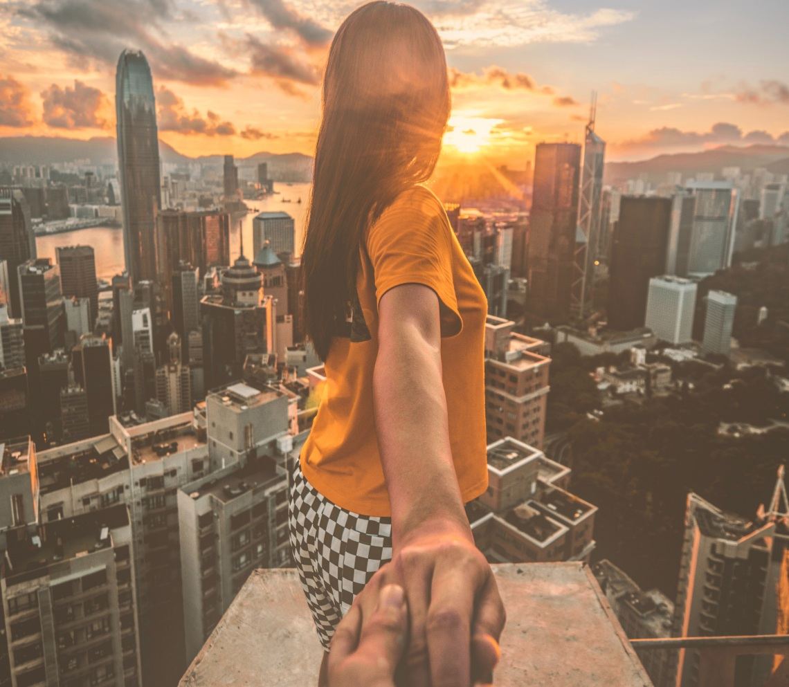 couple holding hands, i'll love you better, girl looking at city, couple