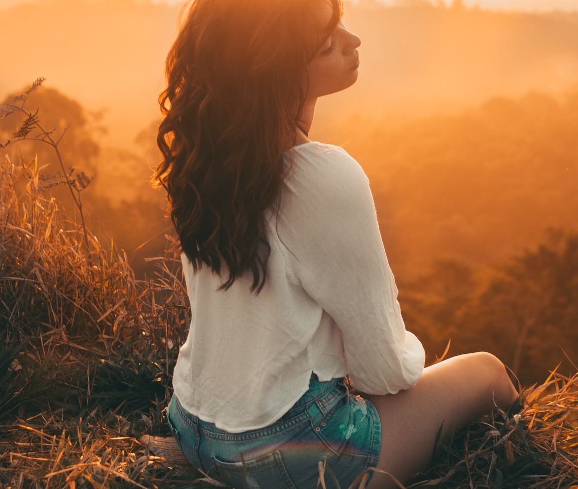 girl in sunset, getting over a break up, moving on