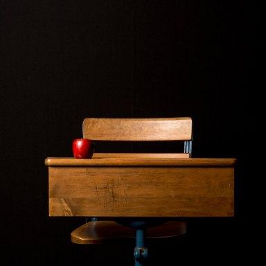 a school desk with an apple on it