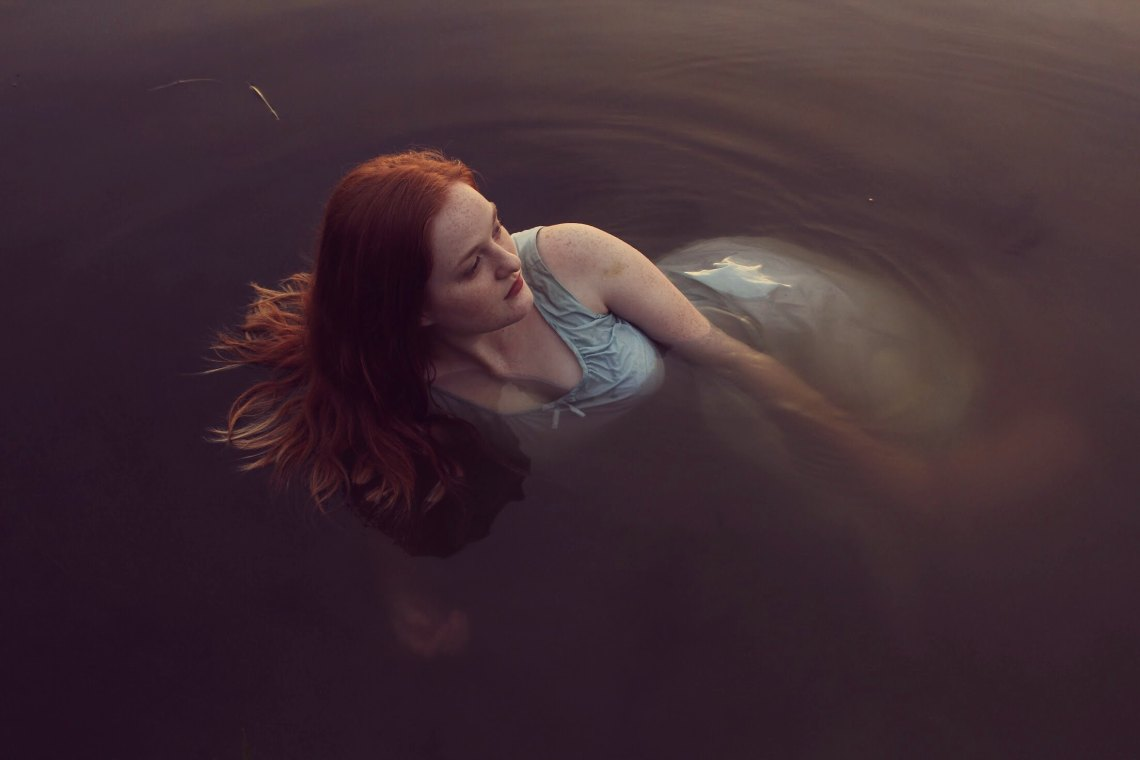 redhead in water