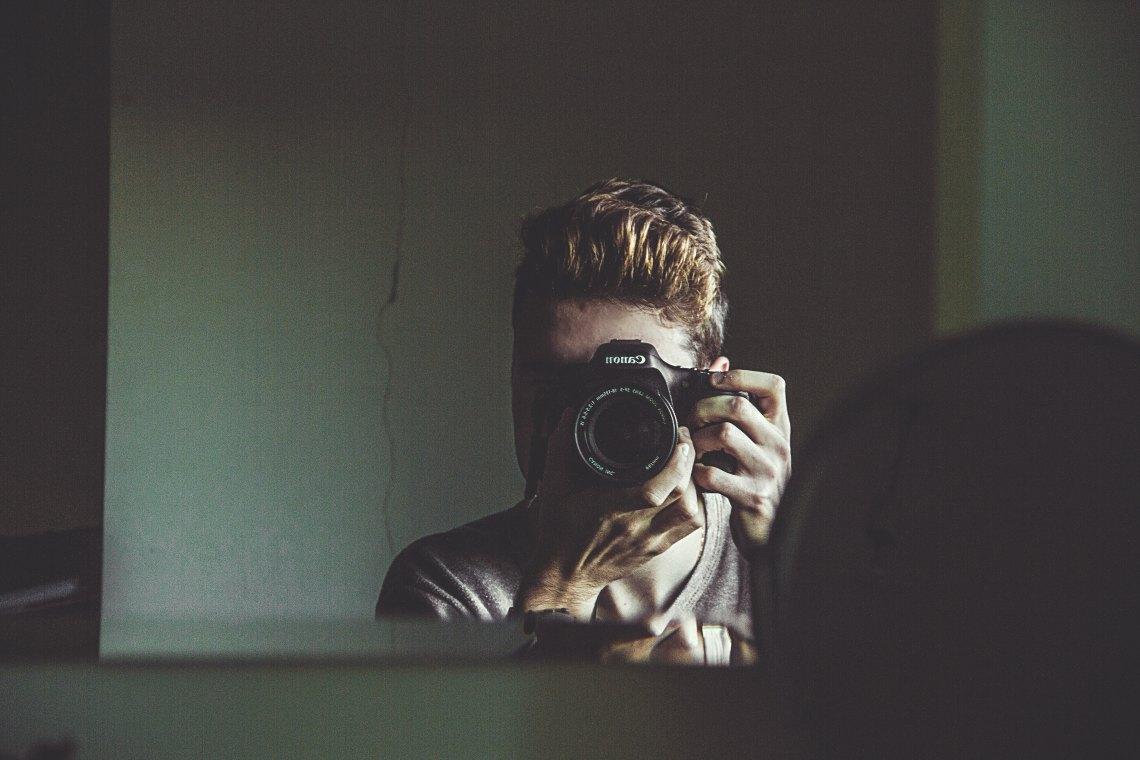 man taking mirror picture