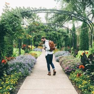 man walking in garden