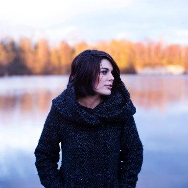 Woman standing over fall lake