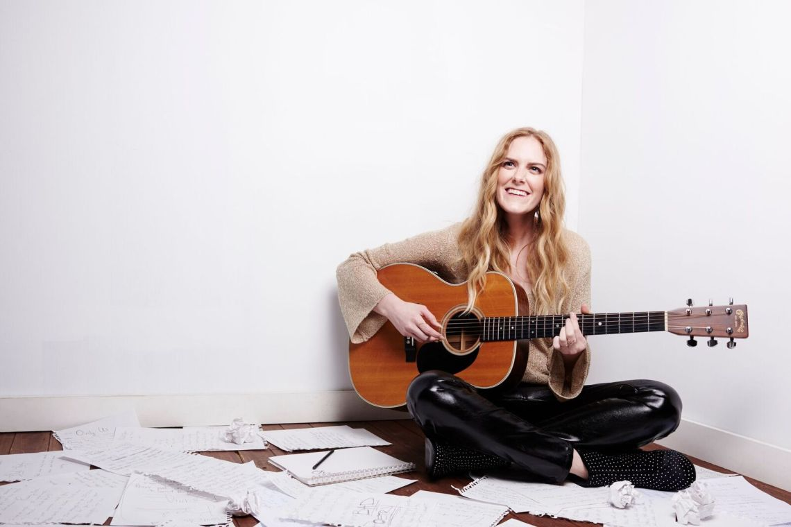 Megan Davies with guitar, Black And White, you are multicolored
