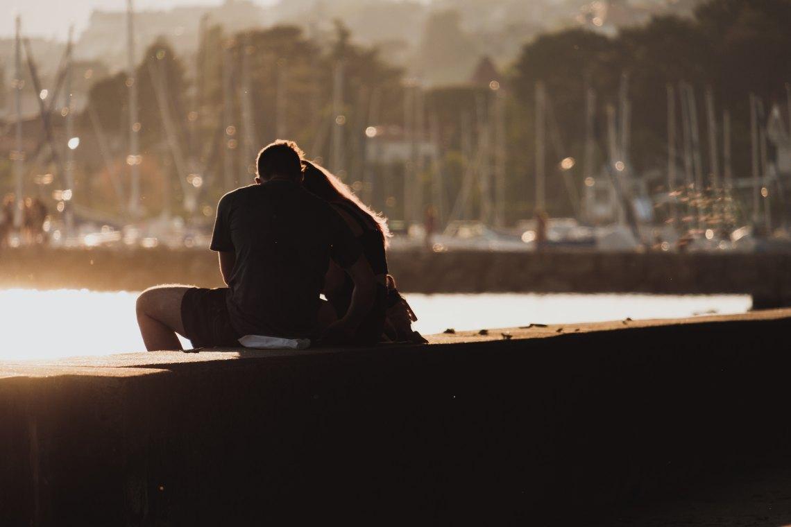 couple sitting on ledge