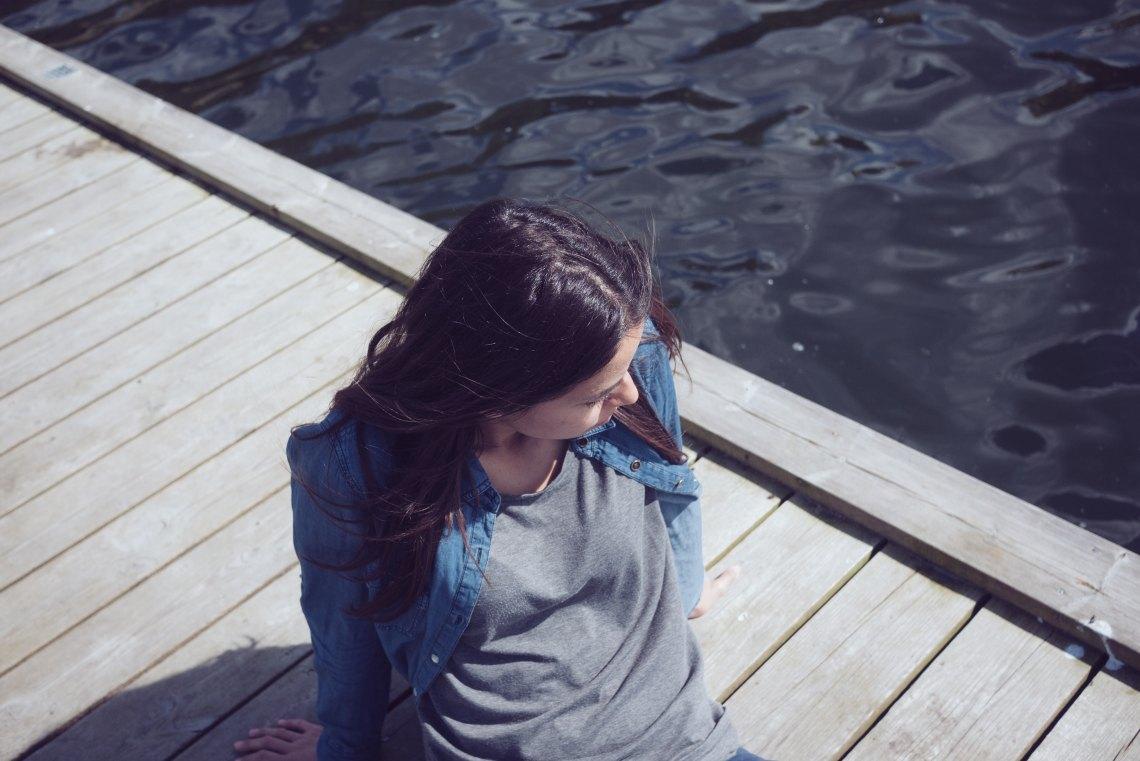 girl sitting on dock