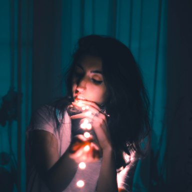 girl in dark with lights