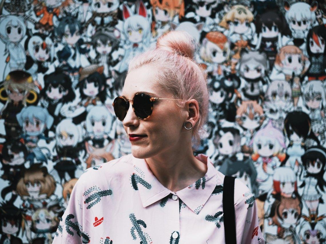 girl with sunglasses and bun