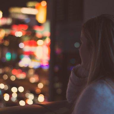 girl looking at city at night