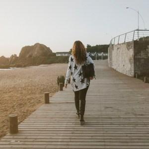 woman walking on boardwalk