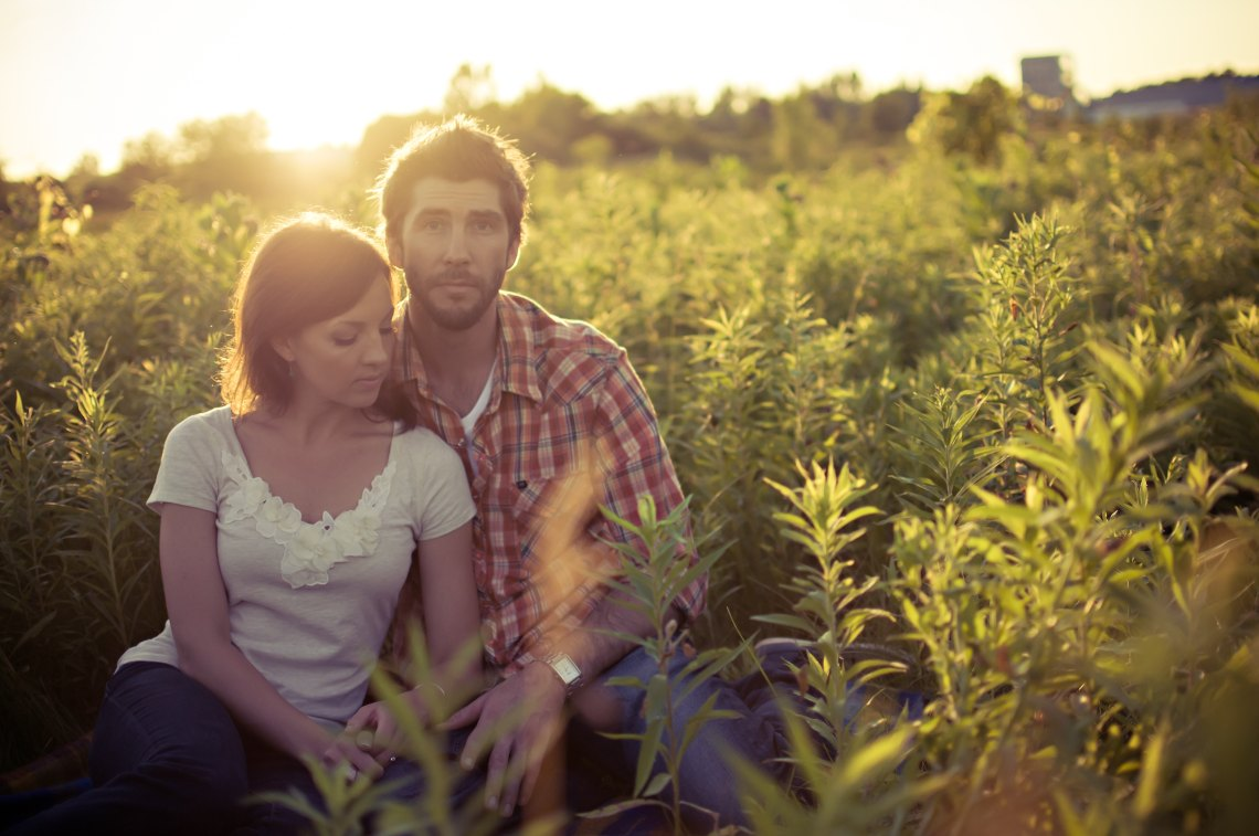 couple sitting in field